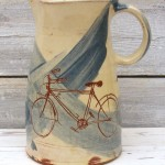 large jug with bike decorations
