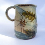 mugs with beetles and leaves